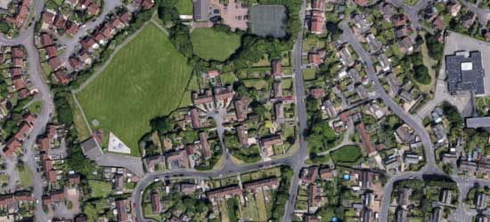 aerial view of Stoke Lodge Community showing houses, streets and the common including the Pavilion